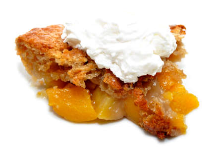 doughy: Whipped Cream on a Slice of Peach Cobbler Stock Photo