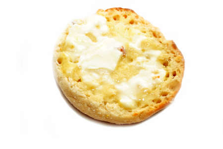 buttered: Buttered English Muffin Isolated on White
