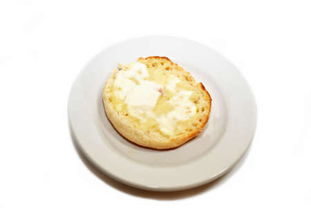 Buttered English Muffin on a Round Plate photo