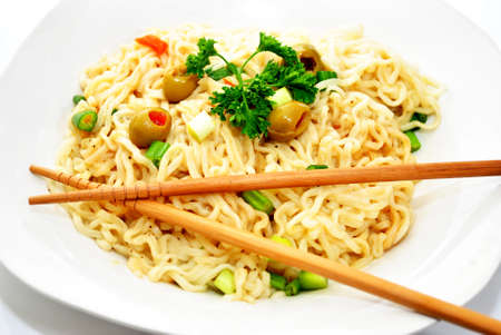 Chopsticks on Noodles and Vegetables photo