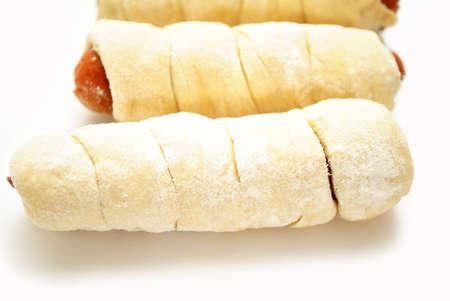 pretzel: Close-Up of Raw Pretzel Dogs Over White Stock Photo