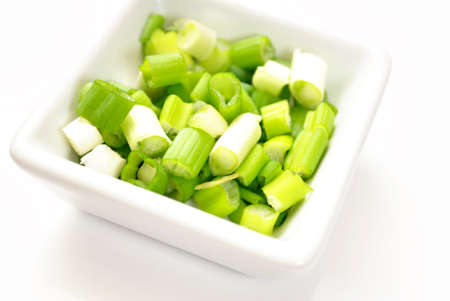 ramosum: Fresh Chopped Chives in a White Square Bowl Stock Photo