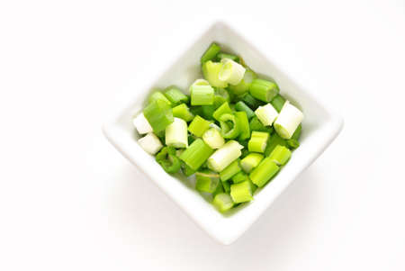 scallions: Green Scallions Chopped in a Square Bowl