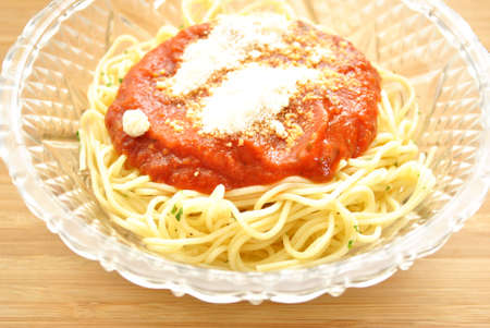 Spaghetti with Sauce and Grated Cheese Фото со стока