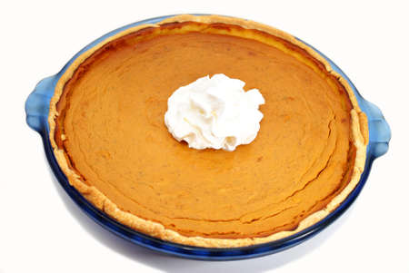 A Whole Fresh Baked Pumpkin Pie with Whipped Cream photo