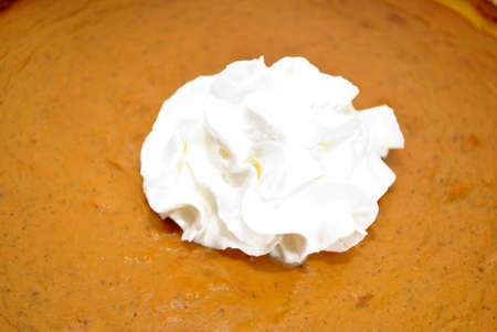 Close-Up of Whipped Cream on a Fresh Pumpkin Pie photo