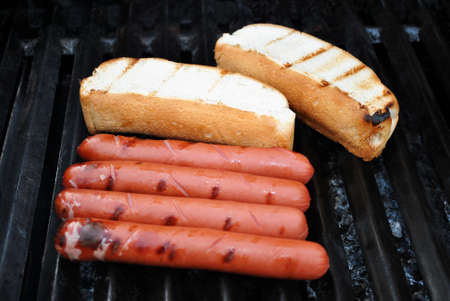 Hot Dogs and Buns on a Summer Grill photo
