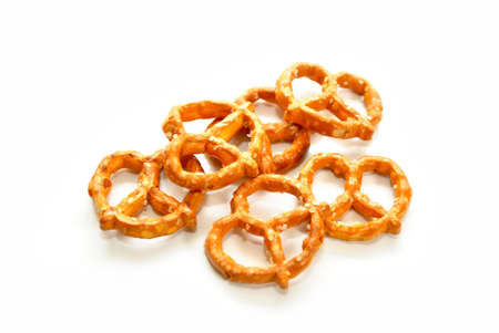 Salty Pretzels Over a White Background Stock Photo