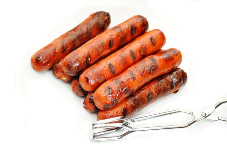 Grilled Hotdogs with Tongs Over White photo
