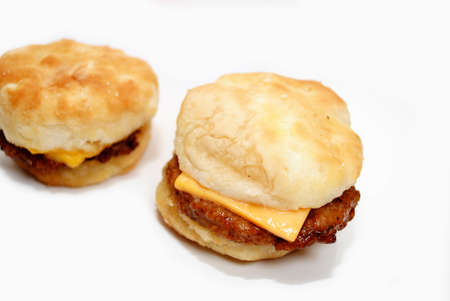 cheesy: A Delicious Cheesy Sausage Biscuit Sandwich Stock Photo
