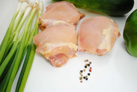 Chicken Thighs, Vegetables and Fresh Pepper Corns Stock Photo