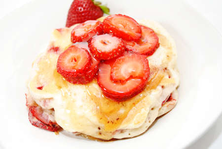 hotcakes: Fresh Sliced Berries on Top of Hotcakes Stock Photo