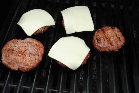 고기의: Melting Cheese on Meaty Burgers on a Grill