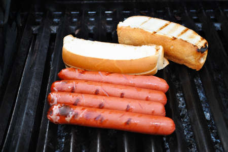 Hot Dogs and Buns Cooking on a Hot Grill photo