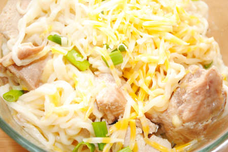 Ramen Noodles with Cheese, Chicken and Chives Stock Photo