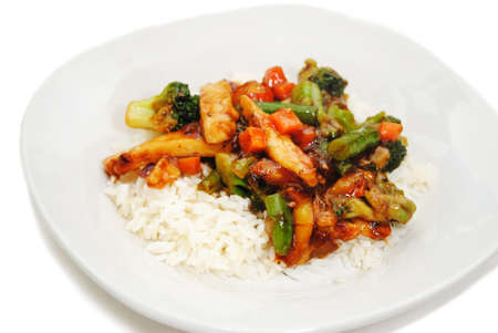 Chicken and Vegetables Stir Fry Served on White Rice