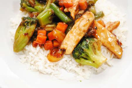 Stir Fried Chicken and Vegetables Served Over White Rice Reklamní fotografie