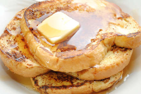 Close-Up of French Toast with Butter and Syrup photo