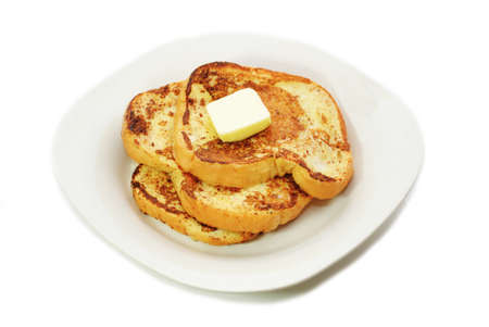 Fried French Toast served on a Plate with Butter