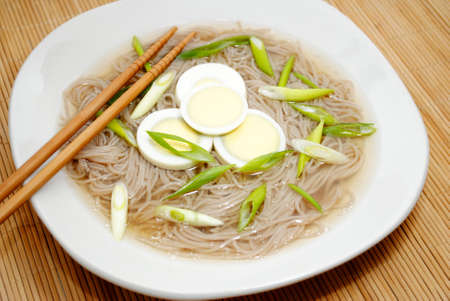 asian noodle: Asian Noodle Soup with Sliced Boiled Eggs Stock Photo