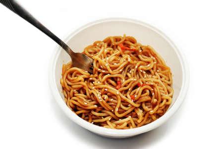 Eating Asian Noodles with Sesame Seeds with a Fork Reklamní fotografie