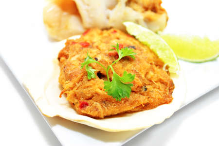 Fancy Stuffed Scallop Shell Served with Fresh Lime Wedges
