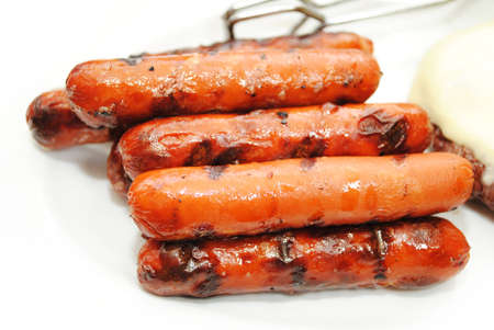 Hotdogs Cooked on a Grill for a Summer Picnic Standard-Bild