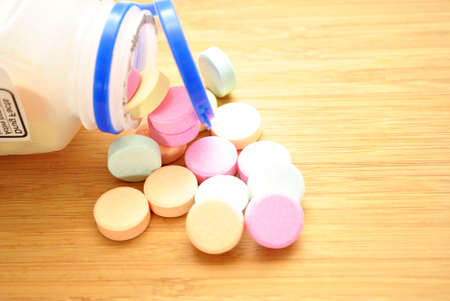 heartburn: Over the Counter Antacids Falling out of the Bottle