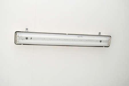 Fluorescent Light Fixture on a White Ceiling photo