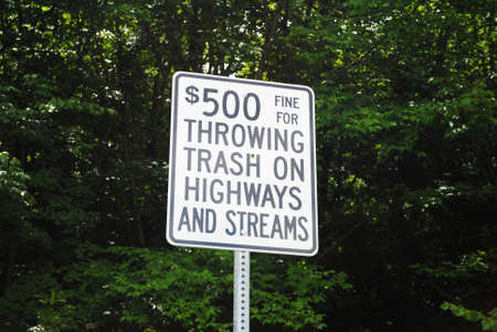 trashed: Sign For Illegal Trash Disposale Stock Photo