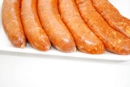 Spicy Sausages with Copy Space Isolated on White
