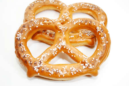 Two Soft Baked Pretzels Isolated Over a White Background Фото со стока