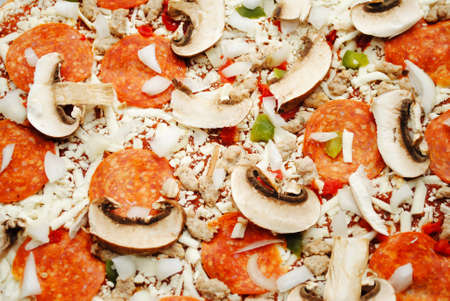 hotter: Back Ground of a Raw Meat and Veggie Pizza