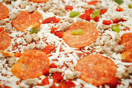 hotter: Background of a Pizza of Pepperoni, Cheese, and Peppers