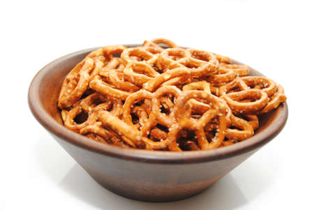 A Brown Wooden Bowl filled with Delicious Pretzels photo