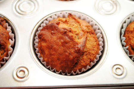 browned: A Browned Banana Muffin Cooling in a Baking Tin