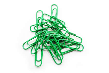 Bright Green Paper Clips Over a White Background