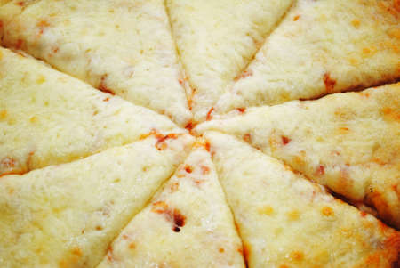 cheesy: Close-Up of the Center of a Sliced Cheesy Pizza Stock Photo