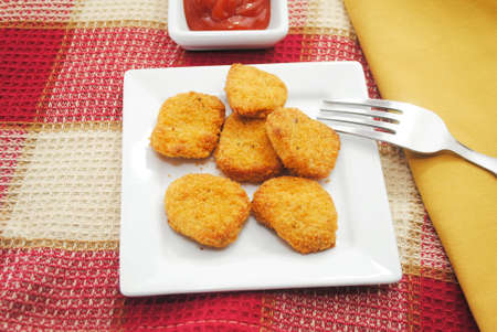 Chicken or Fish Nuggets Served with a Condiment