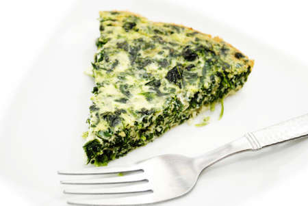 Eating Served Spinach Quiche with a Fork photo