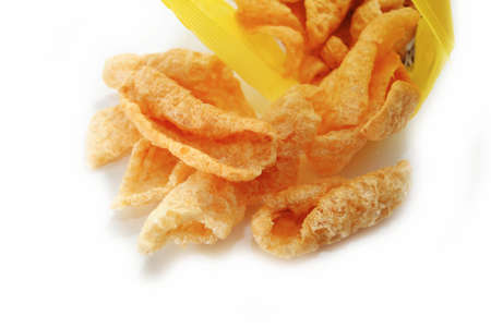 chicharon: Unhealthy Pork Rinds Falling out of a Bag