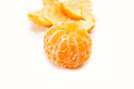 A Whole Peeled Tangerine Ready to Eat photo