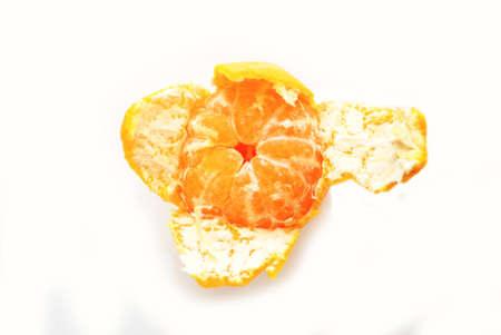 over white: Peeling a Nutritious Mandarin Orange Over White