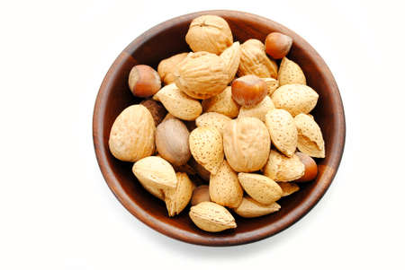 whole pecans: Wooden Bowl Filled with Whole Mixed Nuts Stock Photo