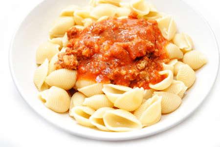 Tomato Bolognese Sauce on Cooked Pasta Shells Фото со стока