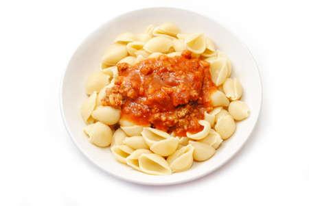 Pasta Shells Topped with Bolenaise sauce Фото со стока