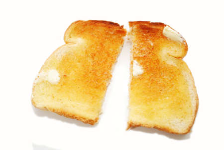 buttered: A Slice of Buttered Toast Cut in Half