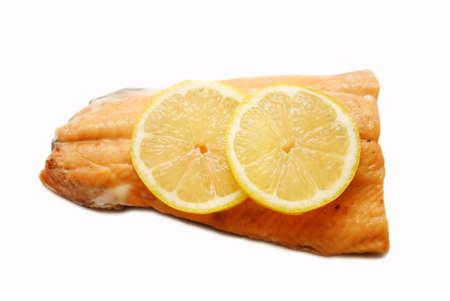 salmon steak: Fresh Lemon Slices on a Organic Salmon Steak