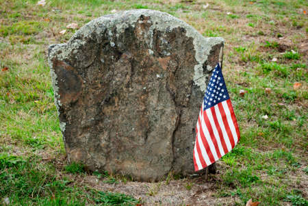 head stones: American Flag in Front of a Nameless Head Stone