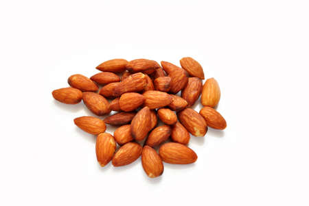 heaped: Raw Almonds Over White